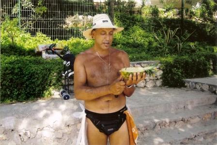 majorca calador beach pineapple seller