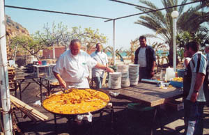 ayo cooking in paella restaurant